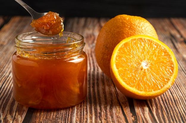 Желтые апельсины с банкой конфитюра. Бесплатные Фотографии