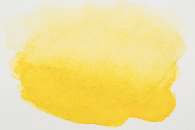 Yellow paints on white sheet Free Photo