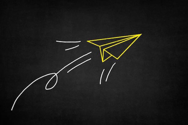 Yellow paper airplane Free Photo