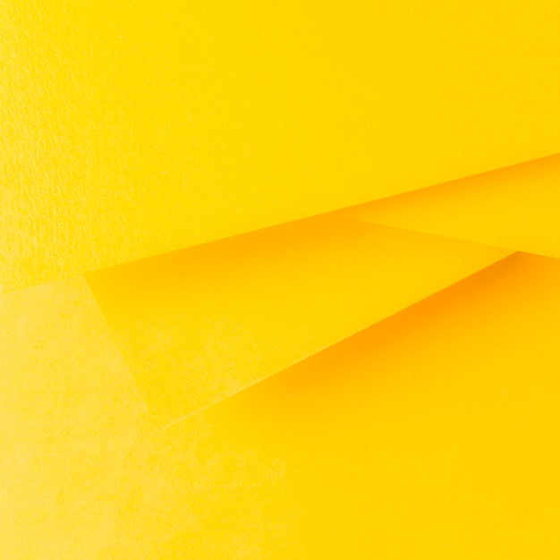 Yellow paper background in minimalist style Premium Photo