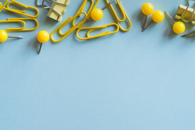 Yellow paper clips push-pins and binder clips Free Photo