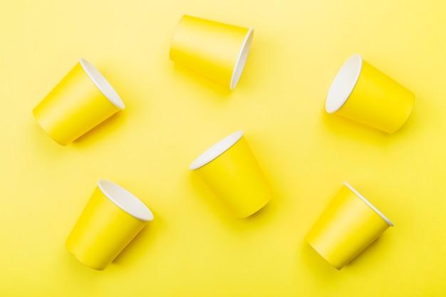 Yellow paper cups on yellow Premium Photo