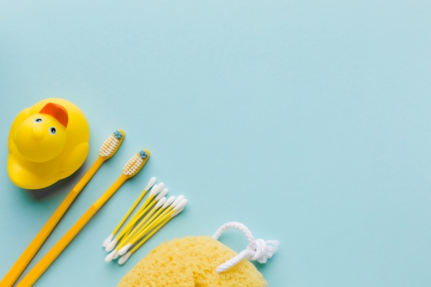 Yellow personal hygiene items copy space Free Photo