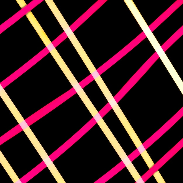 Yellow and pink light grid on black backdrop Free Photo