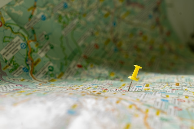 Yellow pinpoint in map Premium Photo