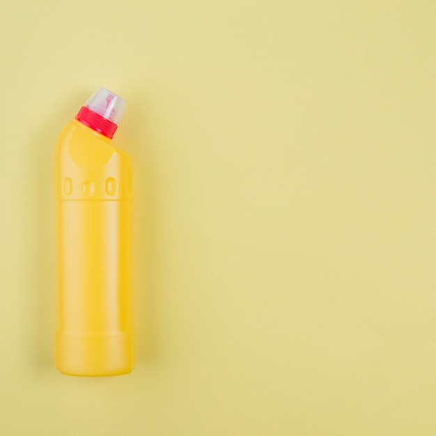 Yellow plastic detergent bottle Free Photo