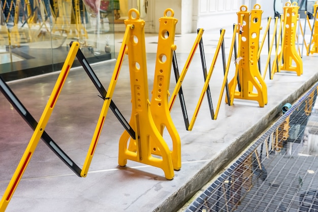 Yellow portable plastic folding safety barrier, traffic fence, yellow fence Premium Photo