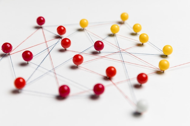 Yellow and red pushpins with thread for route map Free Photo