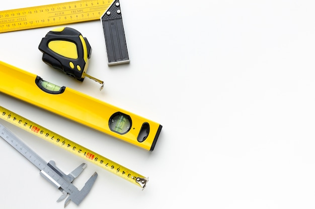 Yellow repair tools with copy space Free Photo