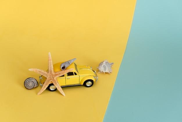 Yellow retro toy car on yellow Premium Photo