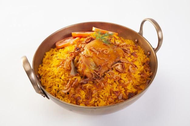 Yellow rice with chicken or chicken biryani with rice Premium Photo
