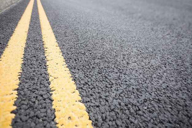 Yellow road marking on road surface Free Photo