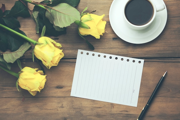 Yellow roses with page and coffee Premium Photo