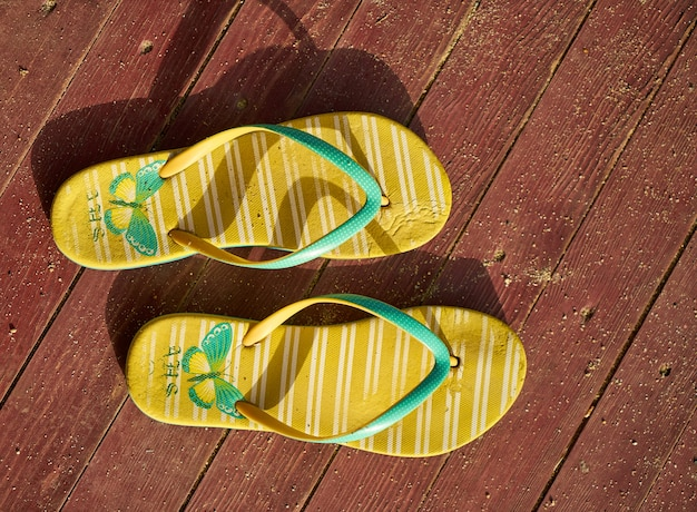 Yellow sandals on wood Free Photo