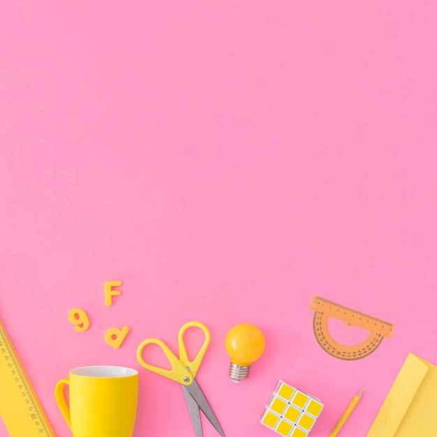 Yellow school stuff on pink Free Photo