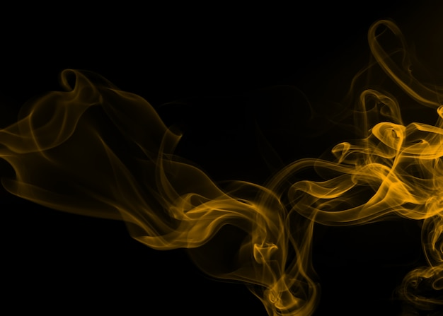 Yellow smoke abstract on black background, fire design Premium Photo