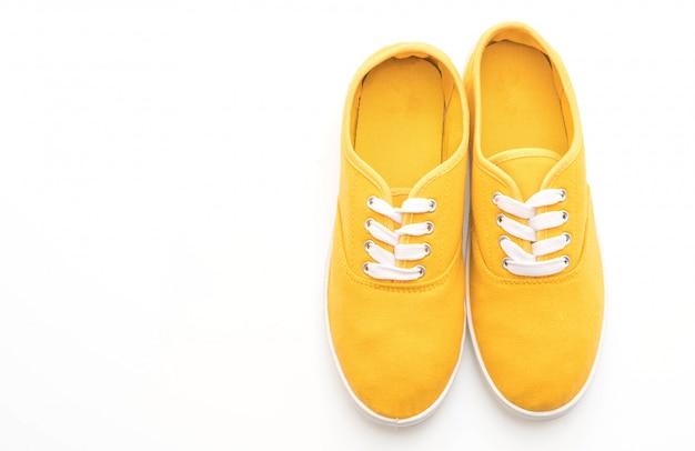 Yellow sneakers on white background Premium Photo