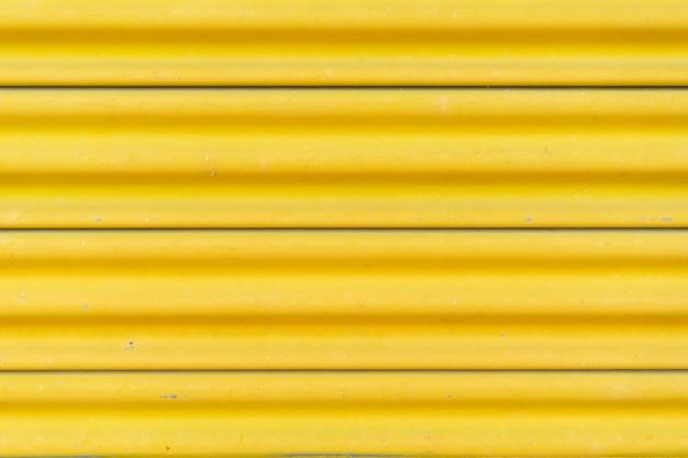 Yellow steel door, beautiful proportions. Premium Photo