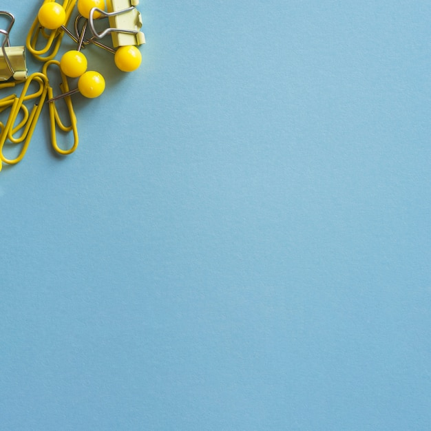 Yellow and steel stationery on blue table Free Photo