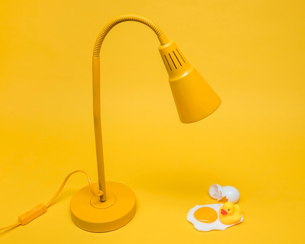Yellow still life of egg under lamp Free Photo