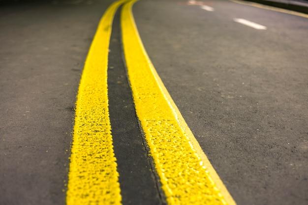 Yellow street marking sign Premium Photo