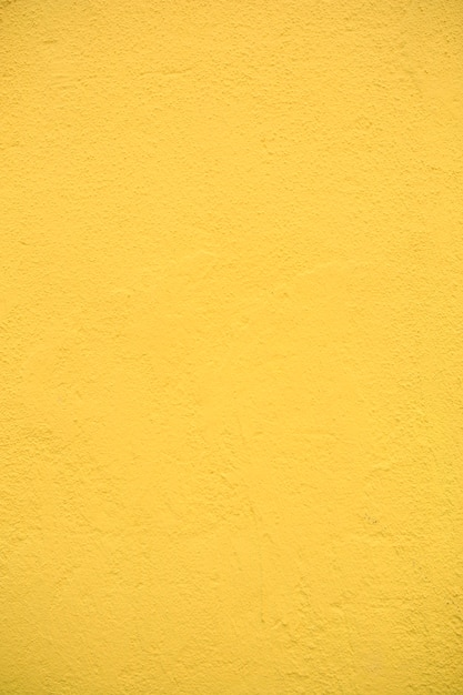 노란색 질감 시멘트 벽 배경 프리미엄 사진