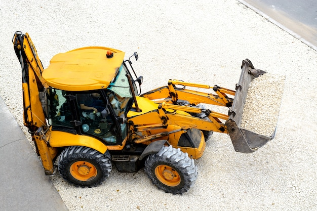 Yellow tractor leads road works Premium Photo