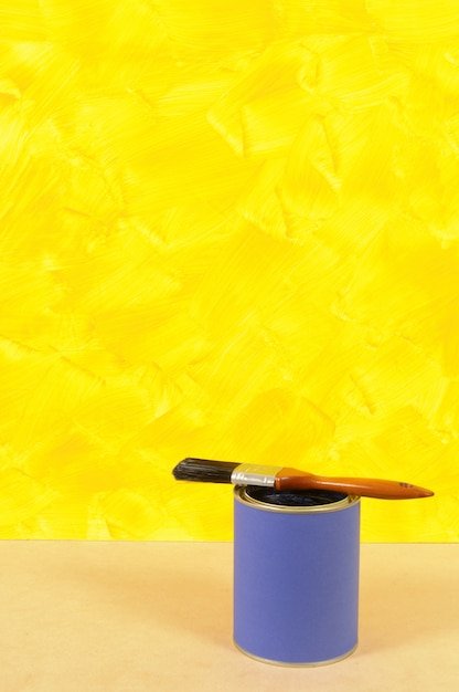 Yellow Wall With Paint Can Photo Free Download