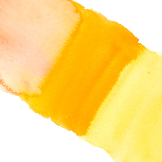 Yellow watercolor wash texture isolated on white backdrop Free Photo