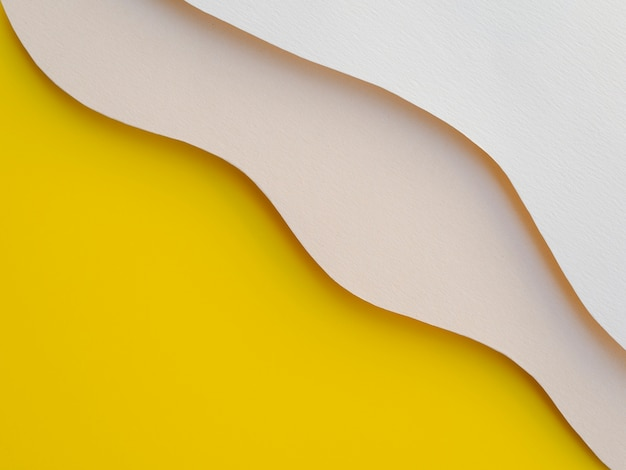 Yellow and white abstract paper waves Free Photo