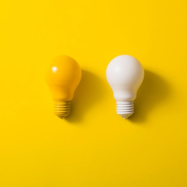 Premium Photo | Yellow and white bulb on yellow background