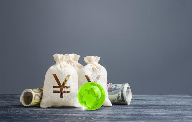 円元マネーバッグ。銀行金融システム、世界準備通貨。経済学、貸付業 Premium写真