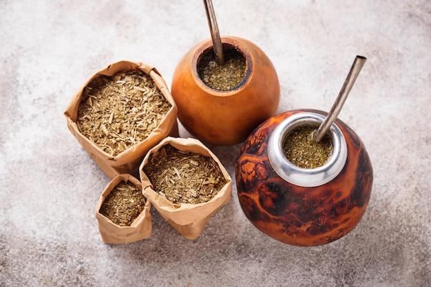 Yerba mate tea with calabash and bombilla. Premium Photo