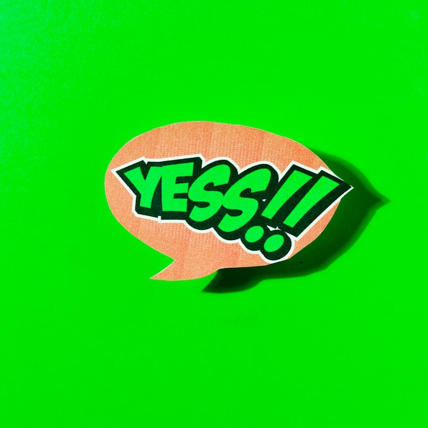 Yes text in speech bubble on green background Free Photo