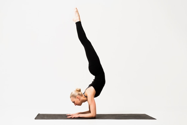 Yoga class candle position execution indoor Free Photo
