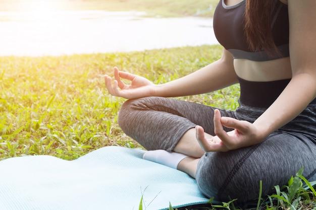 Yoga exercise on river side Premium Photo