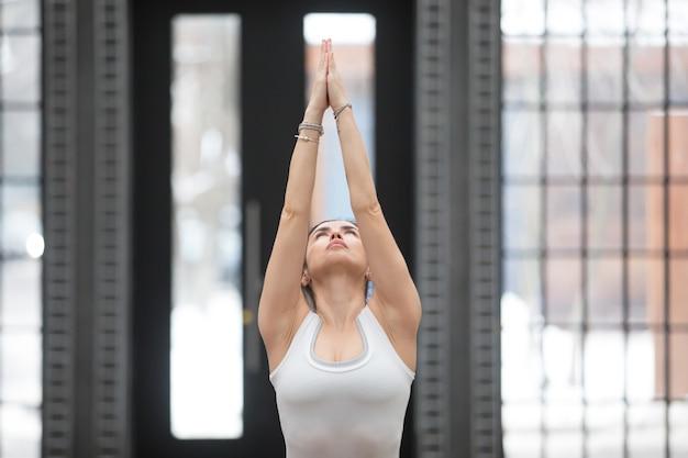 Yoga in fitness center: variation of tadasana pose Free Photo