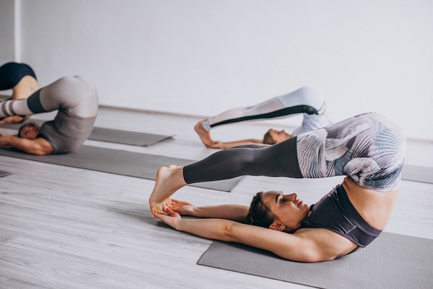 Yoga group classes inside the gym Free Photo