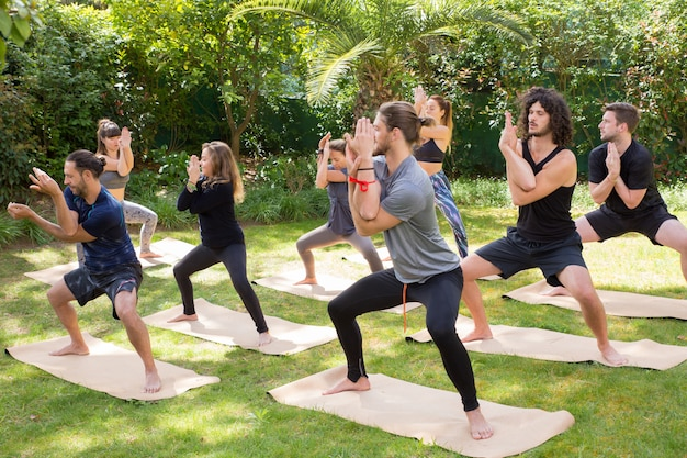 Yoga lovers enjoying practice on grass Free Photo
