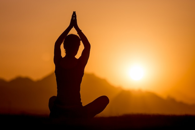 Yoga practice in mountains Free Photo