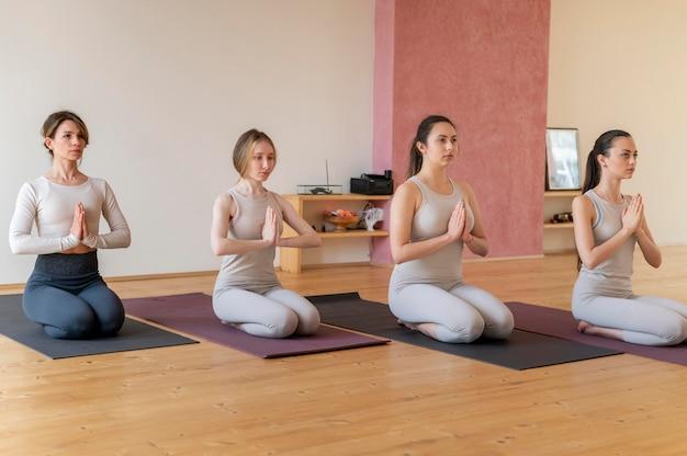 Free Photo | Yoga teacher teaching class
