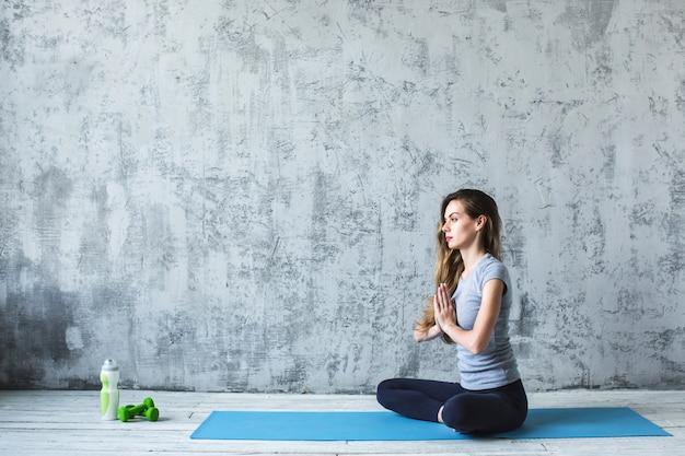 Yoga. woman in lotus relax. Premium Photo