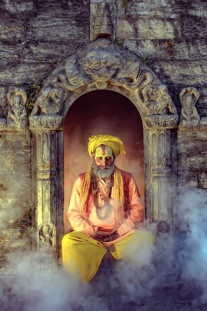 The yogi is meditating peacefully at pashupatinath temple, kathmandu, nepal. Premium Photo