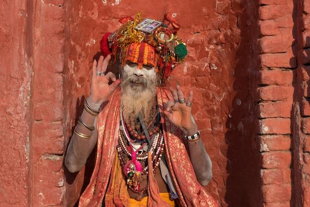 Yogi sitting in prayer in pashupatinath temple nepal of kathmandu Premium Photo
