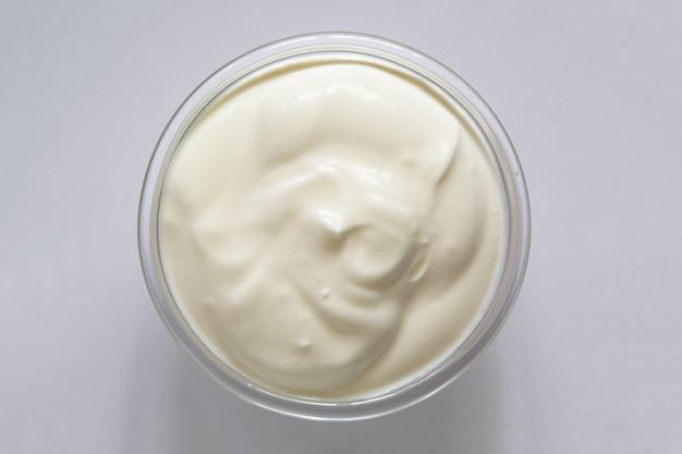 Yogurt or sour cream in a glass bowl Premium Photo