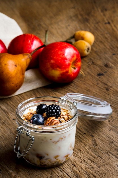 Yogurt with black forest fruits and nuts Free Photo
