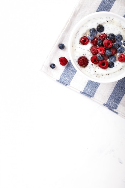 Yogurt with chia seeds and fresh raspberries,blueberries Premium Photo