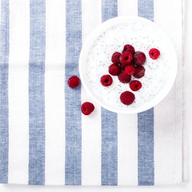 Yogurt with chia seeds and fresh raspberries Premium Photo