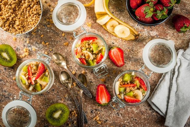 Yogurt with granola and fruits Premium Photo