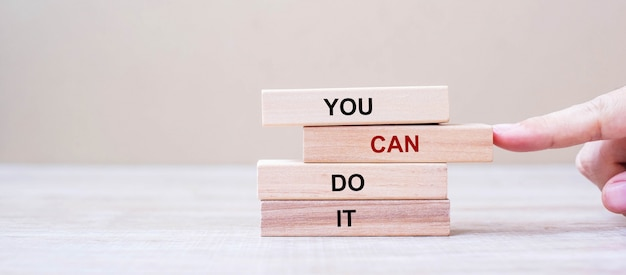 You can do it wooden blocks on table background Premium Photo